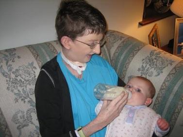 Lisa feeding daughter in '06