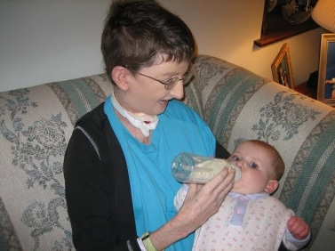 Lisa feeding daughter in '06